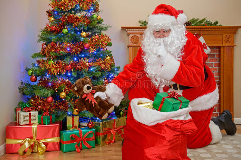 Santa delivering Christmas presents. stock photos