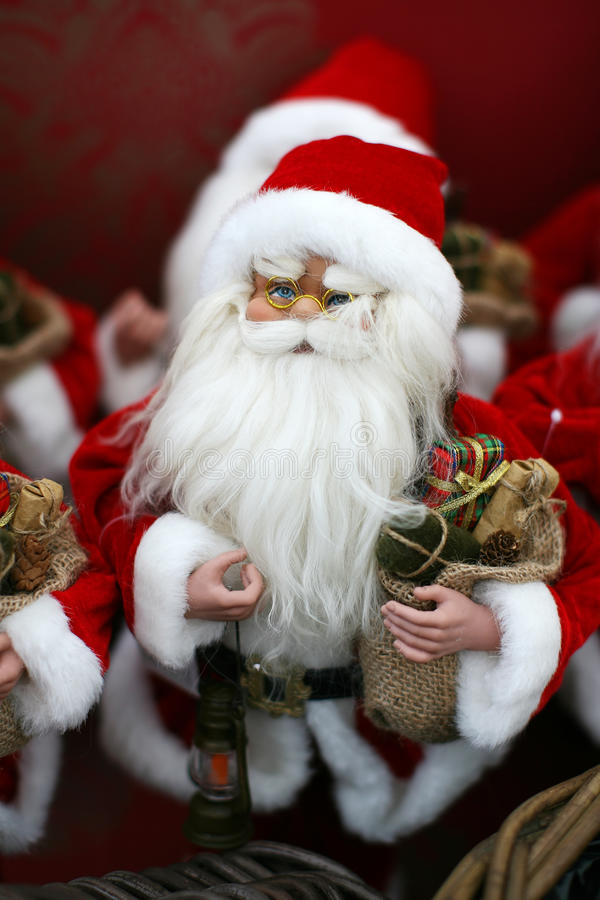 Santa doll. With a bag full of presents and a lamp stock photography