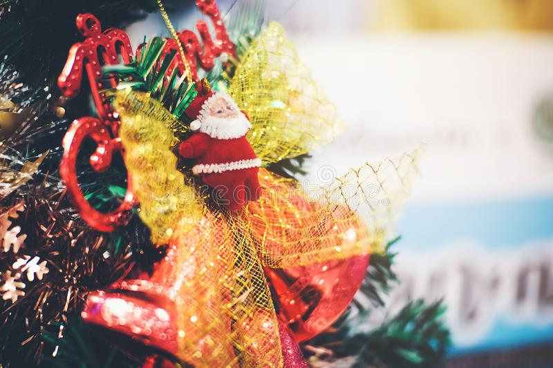 Santa doll on a Christmas tree that is decorated in celebration stock photos