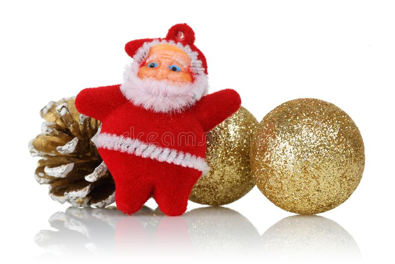 Santa doll with golden spheres and pine cones. Christmas ornaments isolated on white background royalty free stock photo
