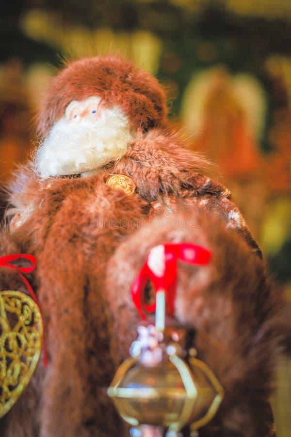 Santa Doll wearing a Fur coat. Christmas Santa doll wearing a fur coat and fur hat royalty free stock image
