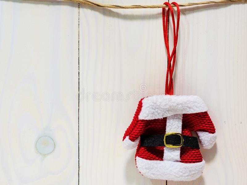 Santa dress hanging on wooden background stock photography