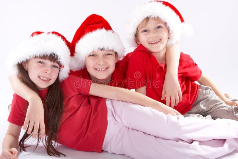 Santa dzieci świąteczne kapeluszy zdjęcia royalty free