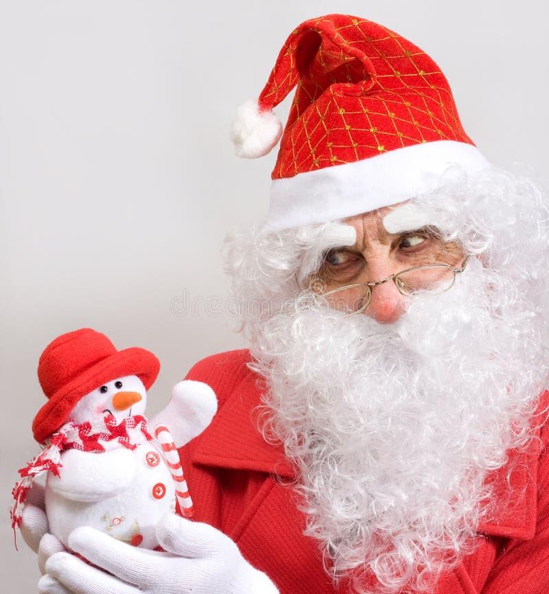 Santa e boneco de neve imagens de stock