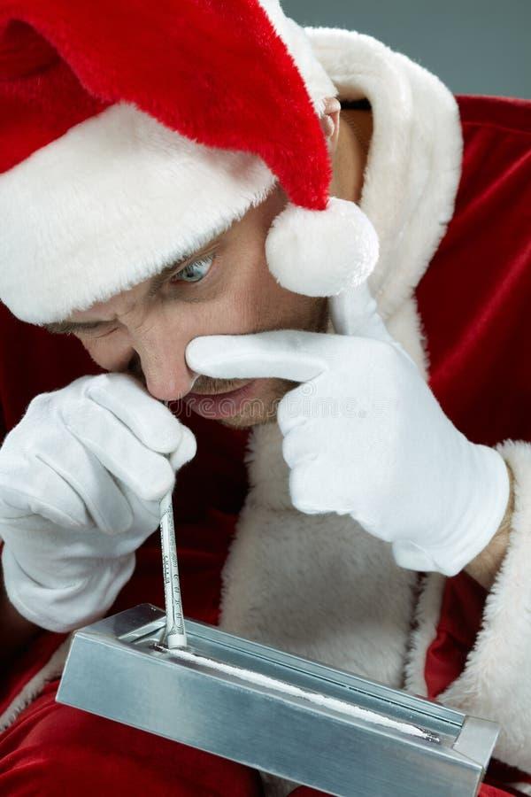 Santa e cocaina immagine stock