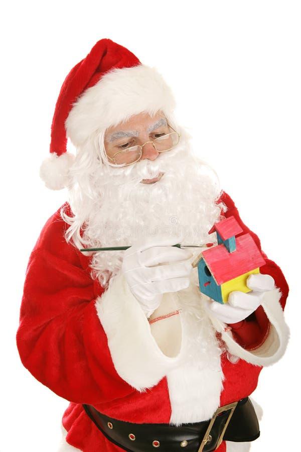 Santa effectuant des jouets images libres de droits