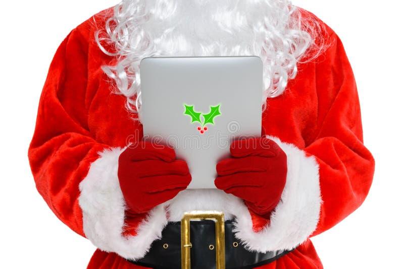 Santa em seu tablet pc foto de stock