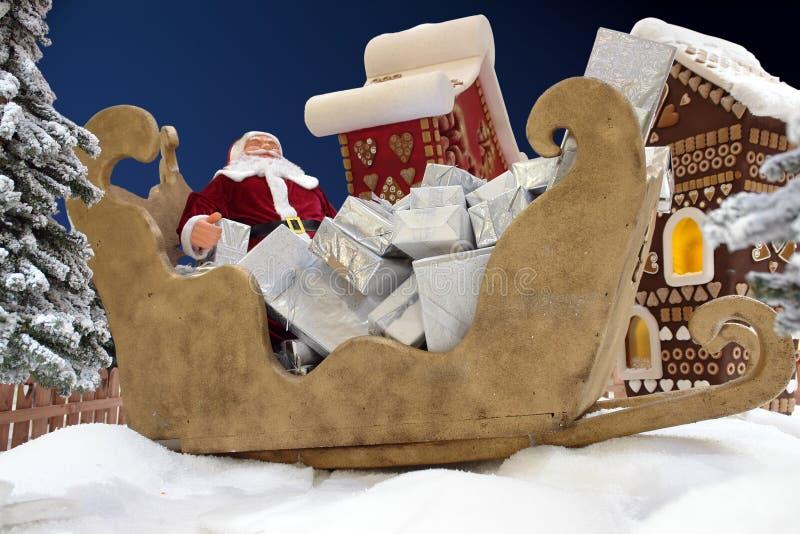 Santa en trineo fotos de archivo