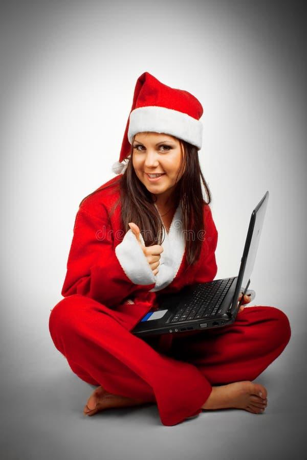 Santa engraçada com computador foto de stock