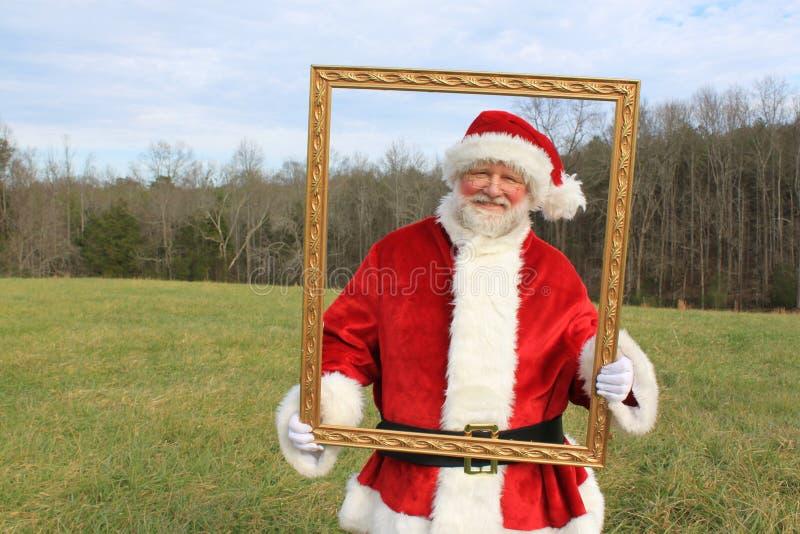 Santa enmarcado imagenes de archivo