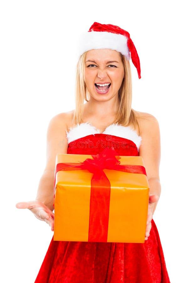 Santa fêmea irritada com presente do Natal imagem de stock