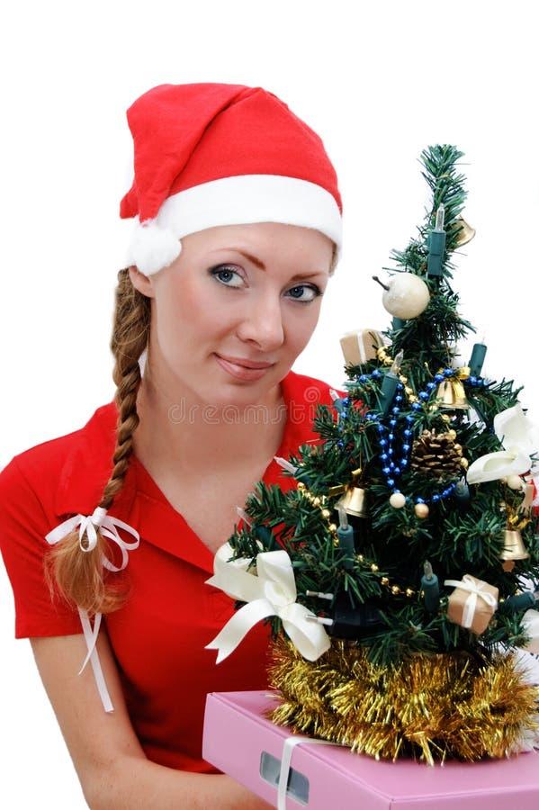 santa för julgåvahjälpreda tree arkivbilder