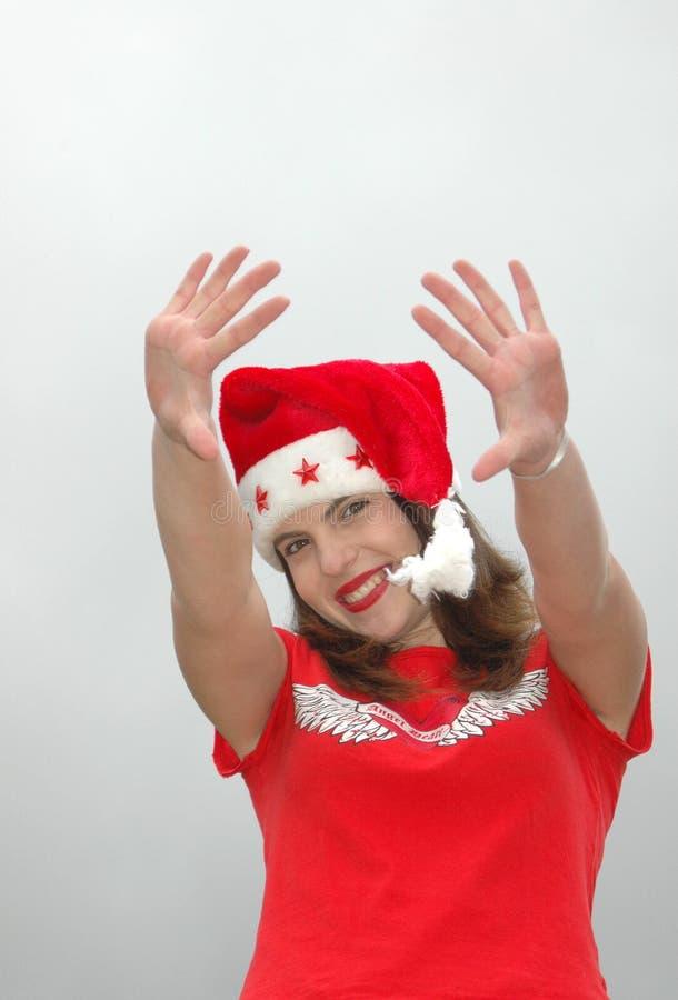 Santa falowania kapelusz kobiety zdjęcie royalty free