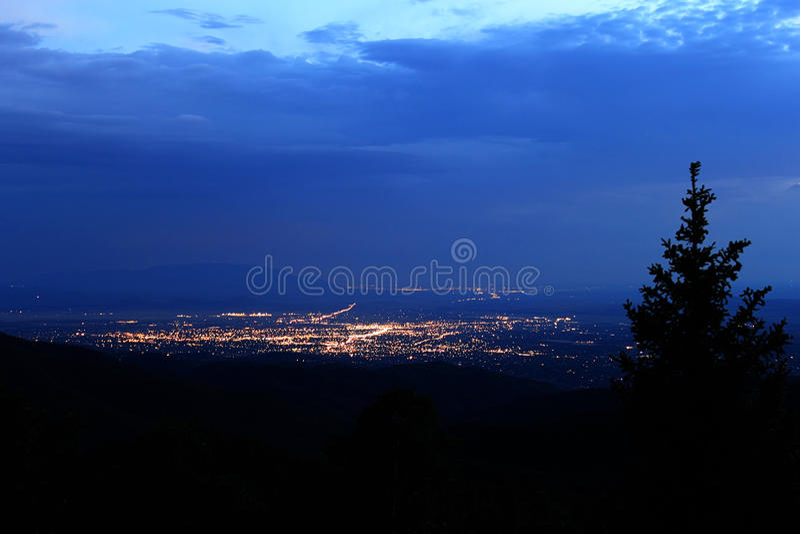 Santa Fe City Lights. Santa Fe, New Mexico city lights view from Carson National Forest stock photos