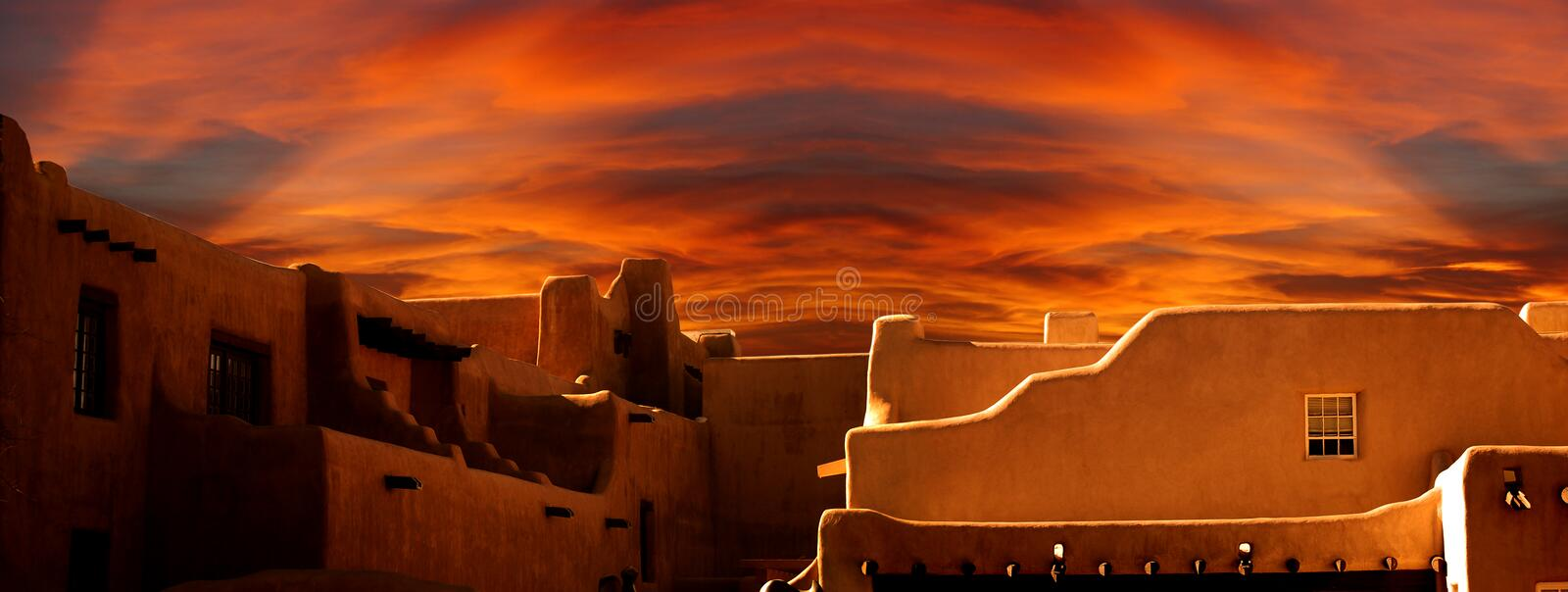 Santa Fe Museum of Art, New Mexico. Stylized panoramic view of the New Mexico Museum of Art at sunset. The building is representative of traditional pueblo stock images