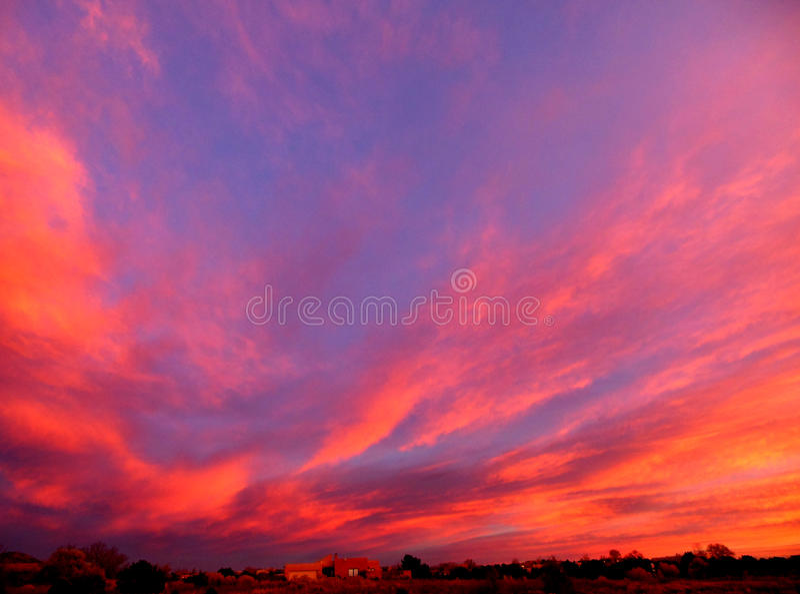 Santa Fe Sunset. Vibrant sunset near Santa Fe, New Mexico paints the sky pink and blue royalty free stock photos
