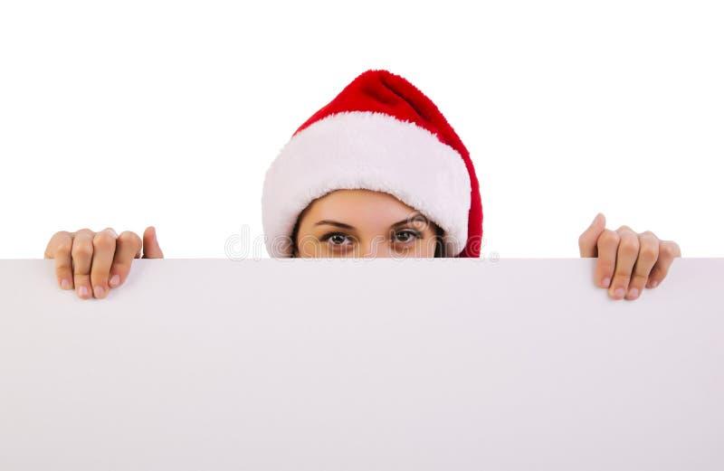 Santa femelle au-dessus d'un panneau-réclame images libres de droits