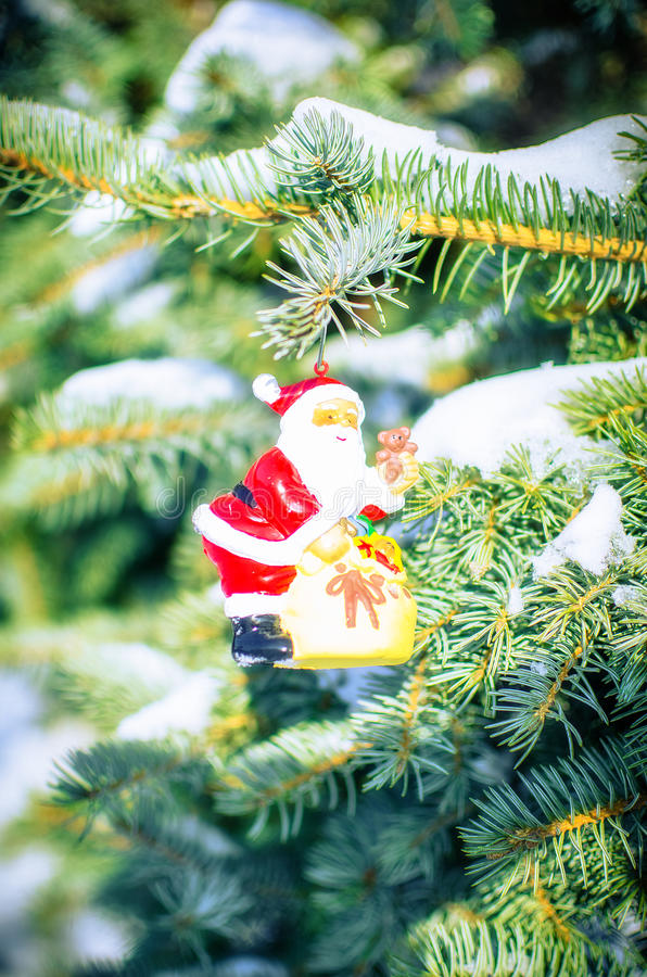 Download Santa On Fir Tree With Snow Outside Stock Photo - Image: 83718768