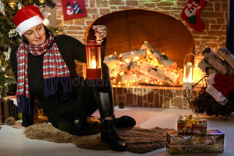 Santa by the fireplace and Christmas tree royalty free stock photo