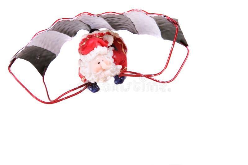 Santa flying on a parachute stock photography