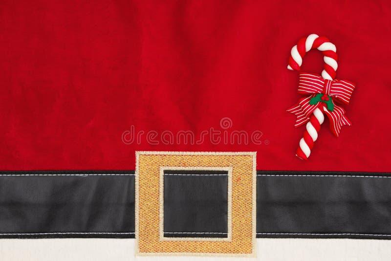 Santa garnitur teksturowany tło z laską cukierkową na wiadomość świąteczną obraz royalty free