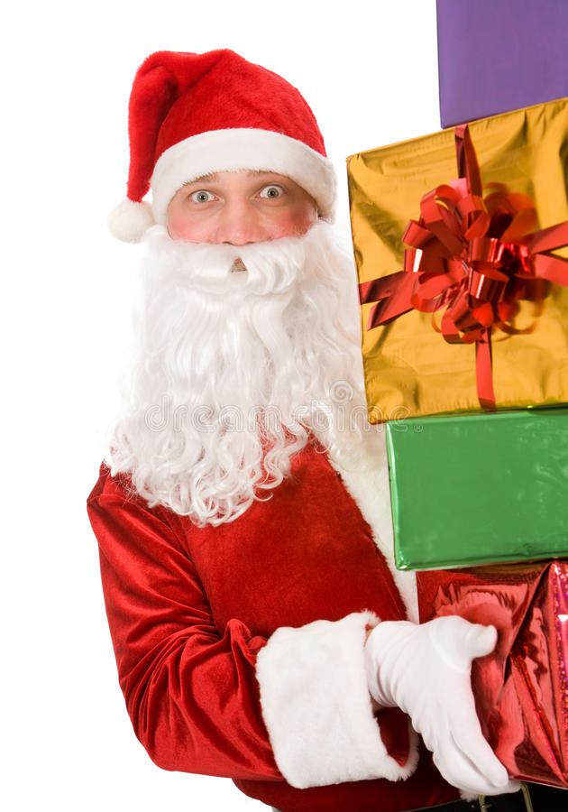 Santa with giftboxes. Photo of happy Santa Claus with several giftboxes in hands royalty free stock images