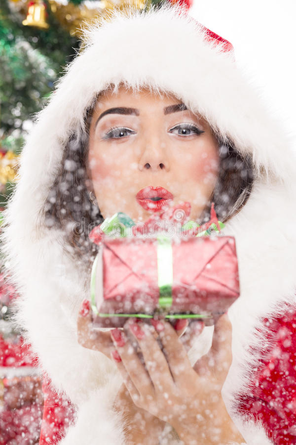 Santa girl blowing snow royalty free stock photography