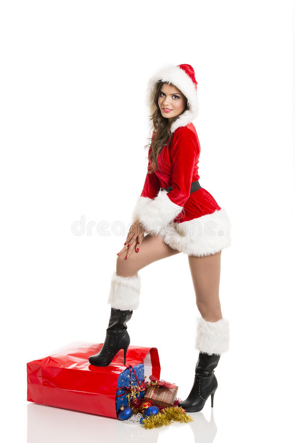 Santa girl with Christmas shopping bag royalty free stock images