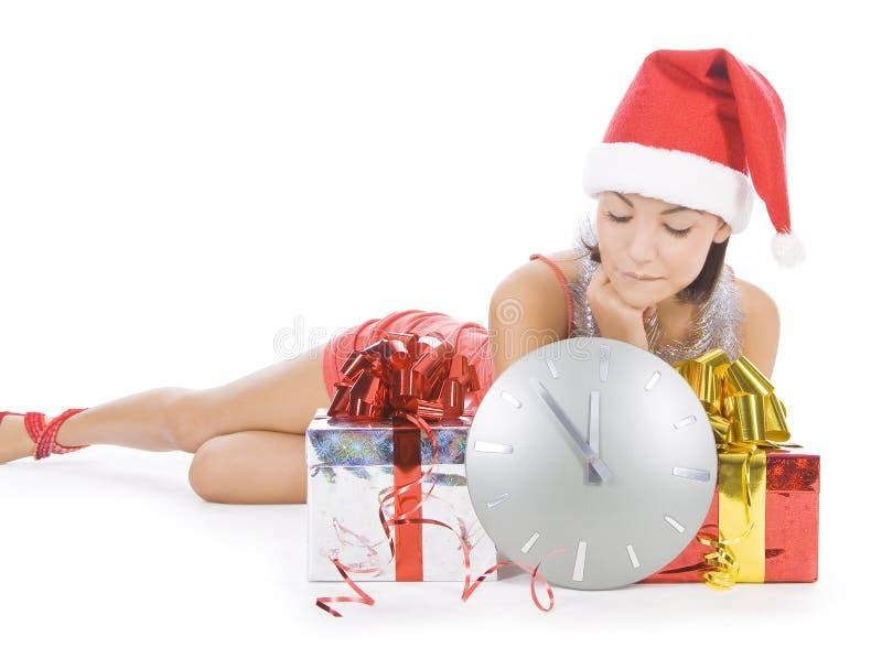 Santa girl with clock waiting midnight royalty free stock photography