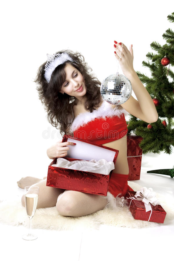 Santa girl deploying boxes with gifts. Images of the beautiful Santa girl which deploying boxes with gifts royalty free stock photo