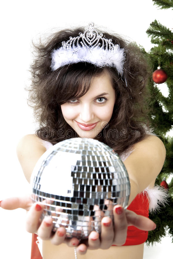 Santa girl disco ball in the hands. Images of the beautiful Santa girl disco ball in the hands royalty free stock photo