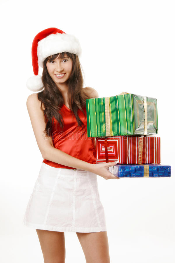 Santa girl with gift boxes royalty free stock photography