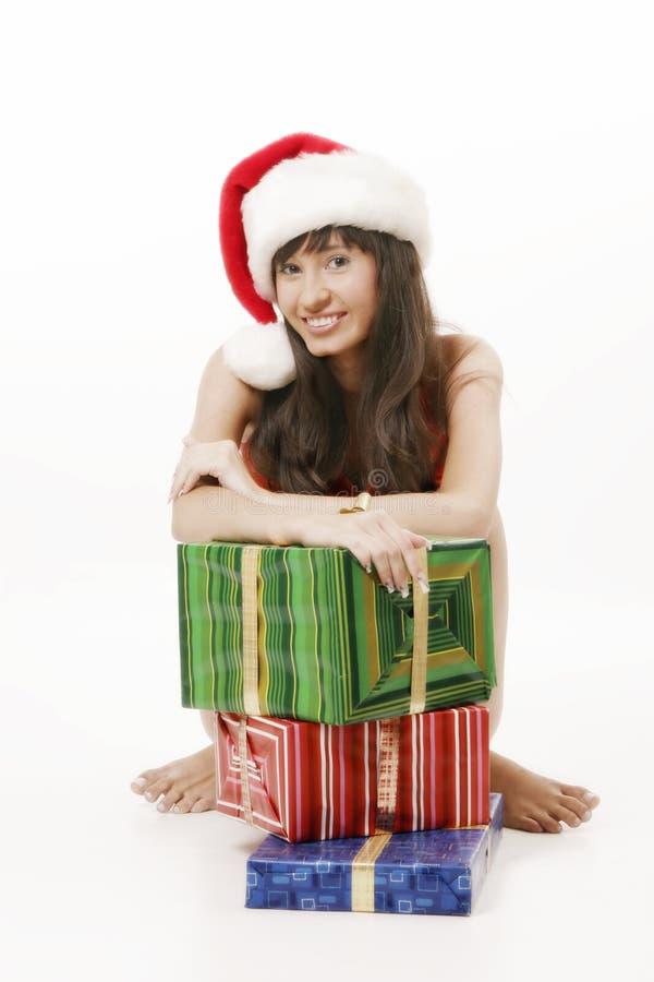 Santa girl with gift boxes stock photos