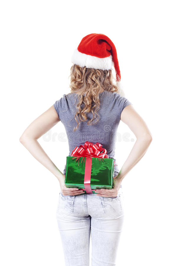 Santa Girl Hiding A Present Gift For New Year Stock Photography