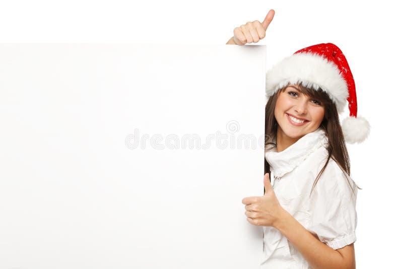 Santa girl holding billboard showing thumb up stock photography