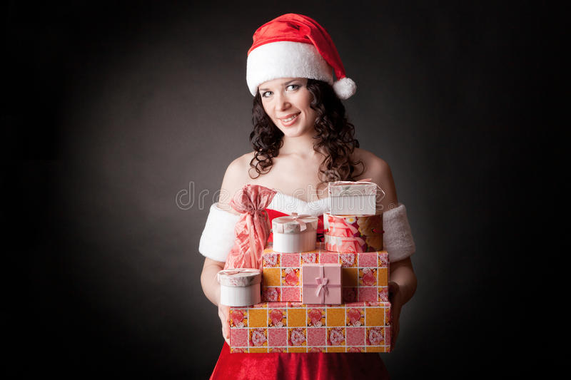Download Santa Girl Is Holding Christmas Gifts. Stock Photo - Image: 27898148