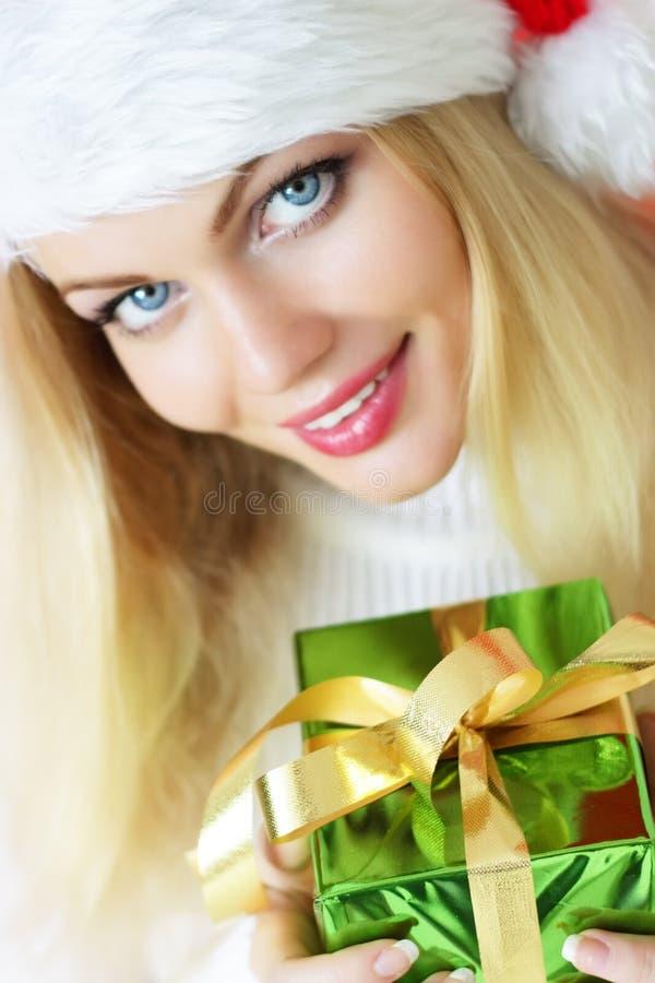 Santa girl holding a gift stock photography