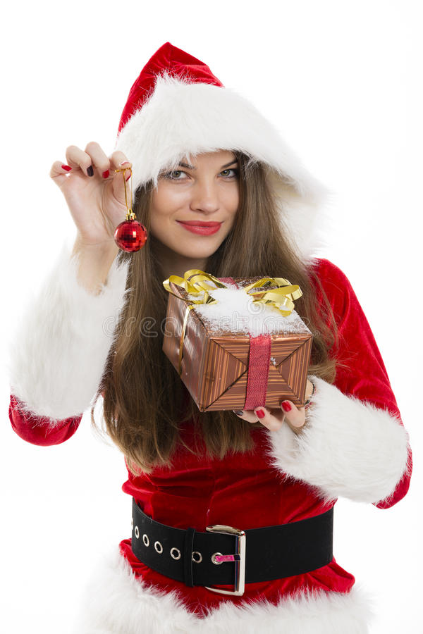 Santa girl holding gift box and red bauble. royalty free stock photography