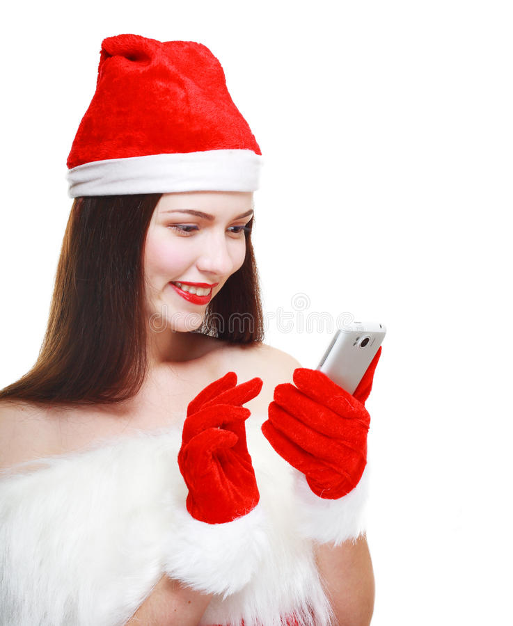 Santa Girl med mobiltelefonen royaltyfri foto