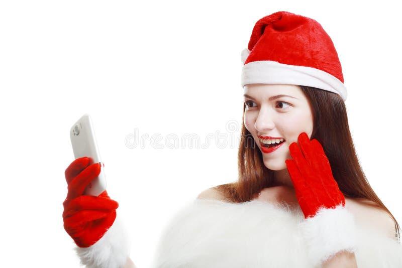 Santa Girl med mobiltelefonen arkivfoto