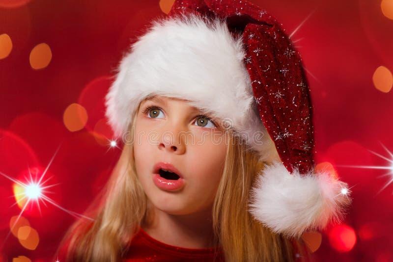 Santa girl overwhelmed stock photo