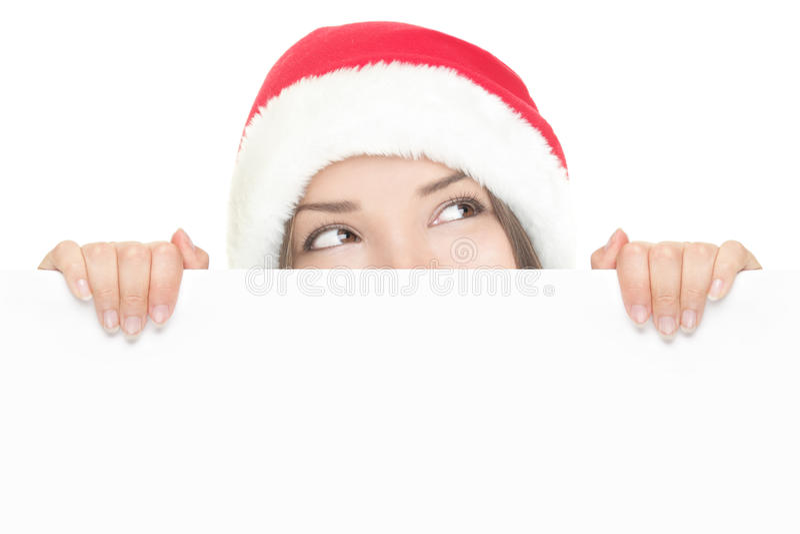 Santa girl peeking over sign board stock photography