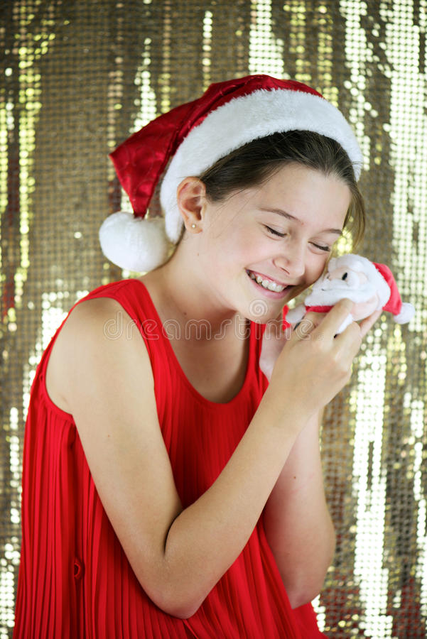 Santa girl. Portrait of little girl eagerly waiting for Christmas and wearing a Santa Claus hat royalty free stock photo