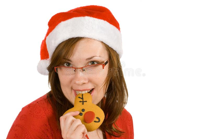 Santa girl with red specs and reindeer gingerbread