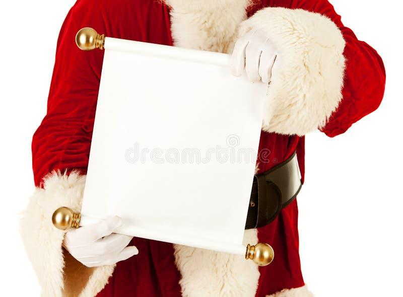 Santa: Guardando um rolo da lista do Natal foto de stock