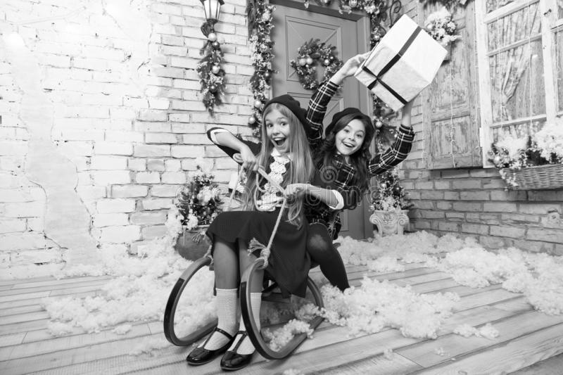 From Santa. Happy new year. Winter. Christmas tree and presents. xmas online shopping. Family holiday. The morning. Before Xmas. Little girls on sledge. Child stock images
