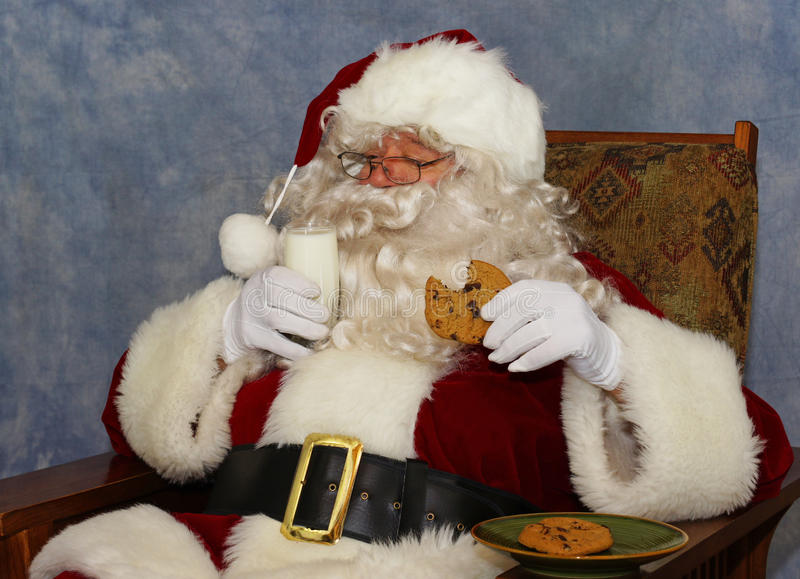 Santa has milk and a cookie royalty free stock photos