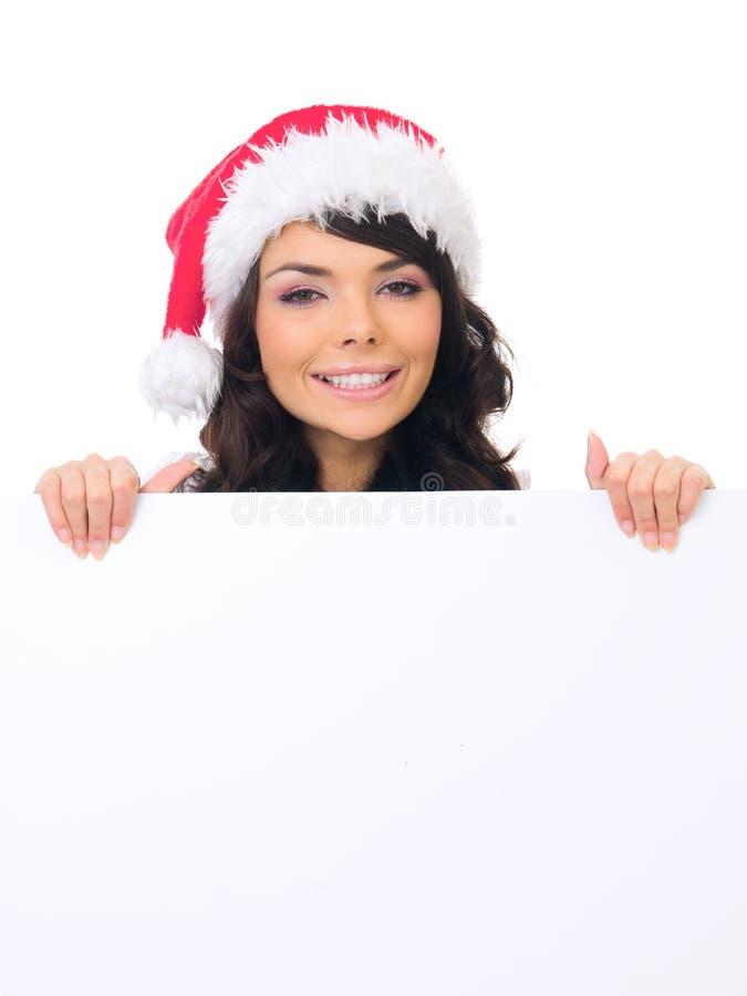 Santa Hat Behind White Board adolescente fêmea nova foto de stock