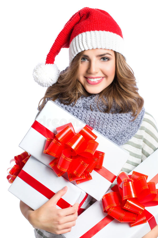 Santa hat Christmas woman holding christmas gifts. stock image