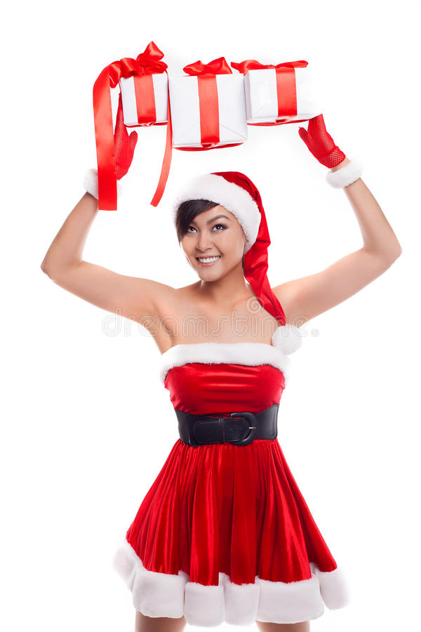 Santa hat Christmas woman holding christmas gifts smiling happy stock image